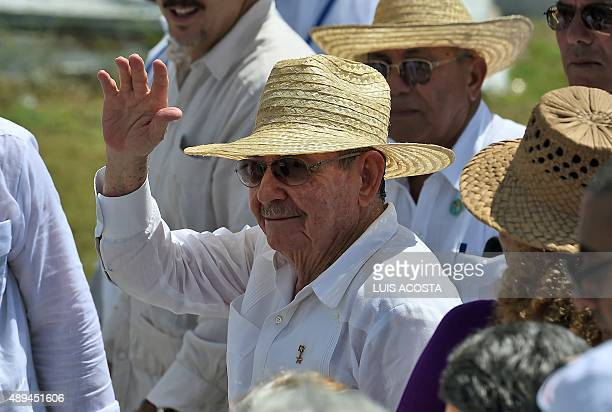 Cuban President Raul Castro waves after greeting Pope Francis at the end of a morning mass at the Calixto Garcia square in Holguin in eastern Cuba on...