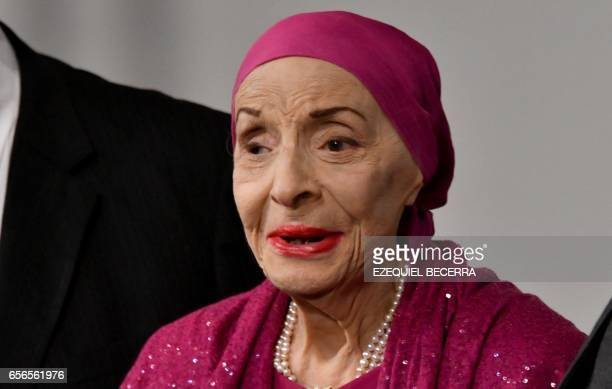 Cuban prima ballerina assoluta and director of Cuba's National Ballet Alicia Alonso gestures during the ceremony in which she received the doctorate...