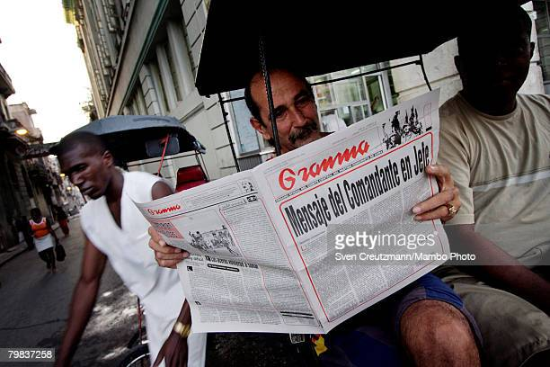 Cuban reads the official communist party newspaper Granma which published a resignation by President Fidel Castro as President and CommanderinChief...