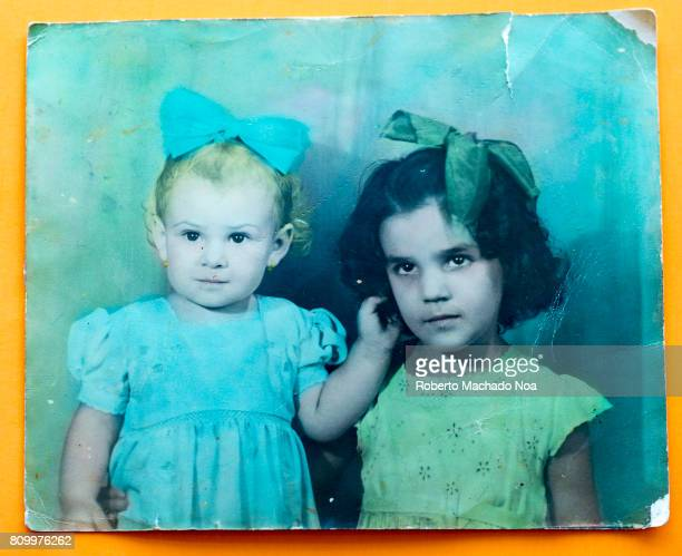 Cuban real people lifestyles at first half of the XX century Old colored portrait of two little girls with bows in their hair