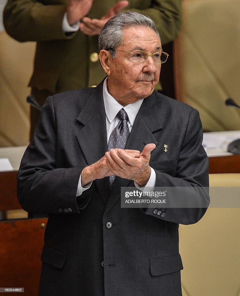 Cuban reelected President Raul Castro applauds at the end of the meeting of the new National Assembly to choose a Council of State, at the Conventions Palace in Havana on February 24, 2013. Cuba's new National Assembly reelected Castro for another five years as President of the communist country. Raul Castro became interim President in 2006 and then formally became president.