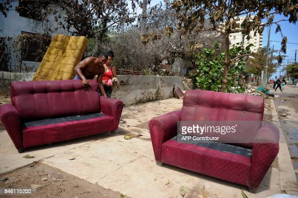 Cuban repair their furniture after the passage of Hurricane Irma in Havana on September 12 2017 / AFP PHOTO / YAMIL LAGE