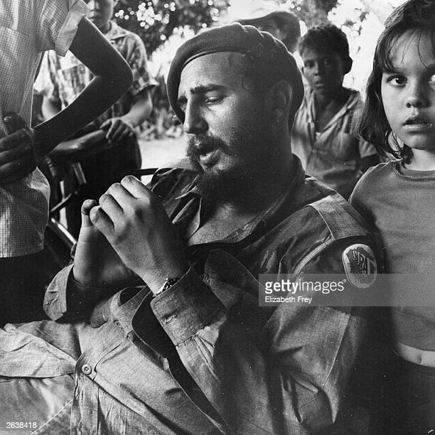 Cuban revolutionary leader Fidel Castro relaxing at a sugar plantation near Havana surrounded by children Original Publication People Disc HC0495