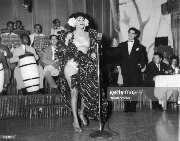 A Cuban rhumba dancer named Zulema performs on stage with a band at the Zombie Club on Zulueta Street Havana Cuba February 16 1946
