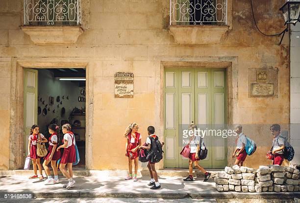 Cuban school children walking on the sidewalk in Havana