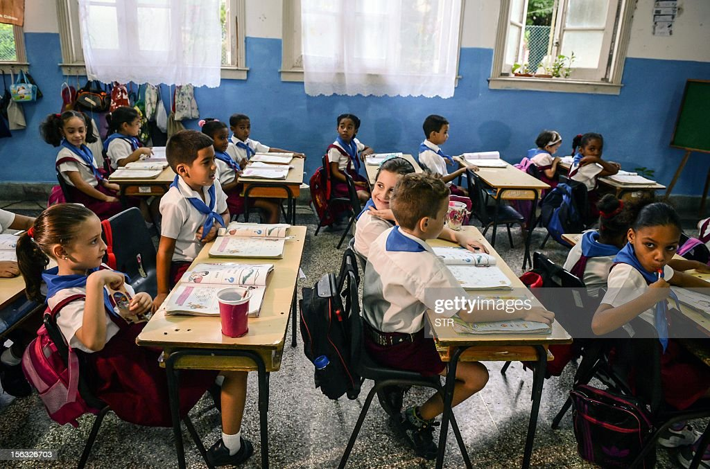 Cuban schoolchildren attend a class in a primary school, on November 13, 2012, in Havana. AFP PHOTO