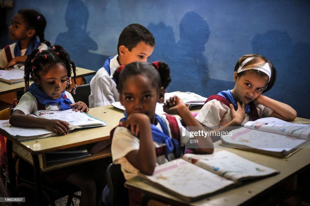 Cuban schoolchildren attend a class in a school in Havana, on November 13, 2012.
