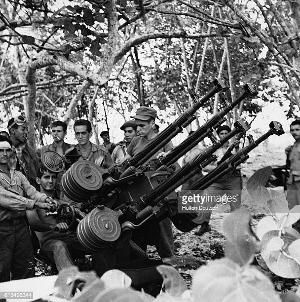 Cuban soldiers demonstrate a beach gun they used during the Bay of Pigs invasion of 1961   Location Playa De Giron Cuba