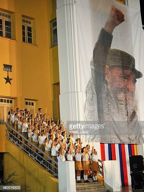 Cuban students carrying pencils reenact the Moncada Barracks attack widely regarded as the beginning of the Cuban Revolution during the celebrations...