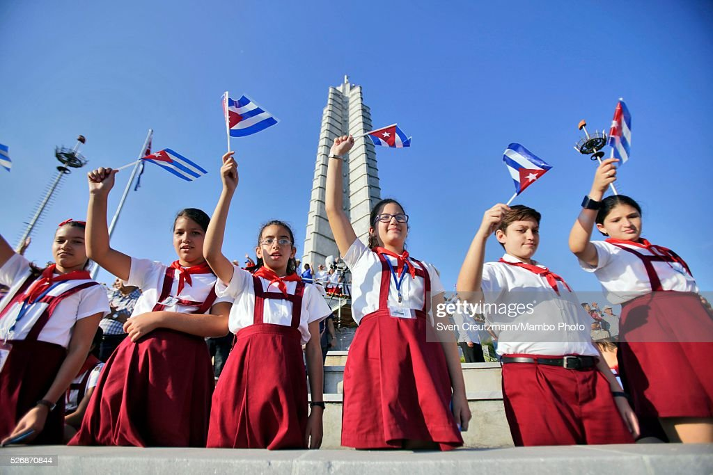 Cuban students wave flags during a march celebrating workers day, at the Plaza de la Revolucion, on May 1, 2016 in Havana, Cuba. Cuba celebrates workers day shortly before the arrival of the first US American cruise ship to arrive in Cuba, on Monday, May 2, 2016.