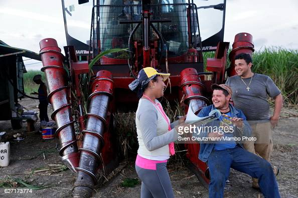 Cuban sugarcane workers share a smile during the zafra the sugarcane harvest in the eastern province of Camagüey on December 1st in Camagüey Cuba...