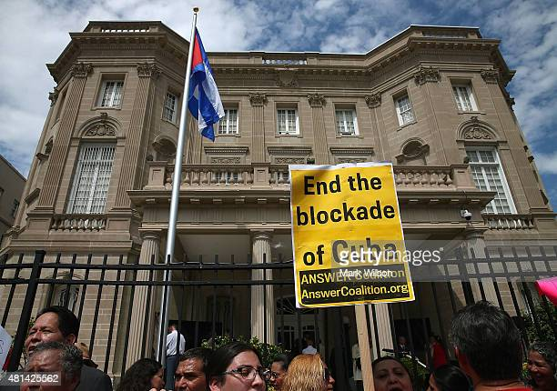Cuban supporters gather in front of the country's embassy after it reopened for the first time in 54 years July 20 2015 in Washington DC The embassy...