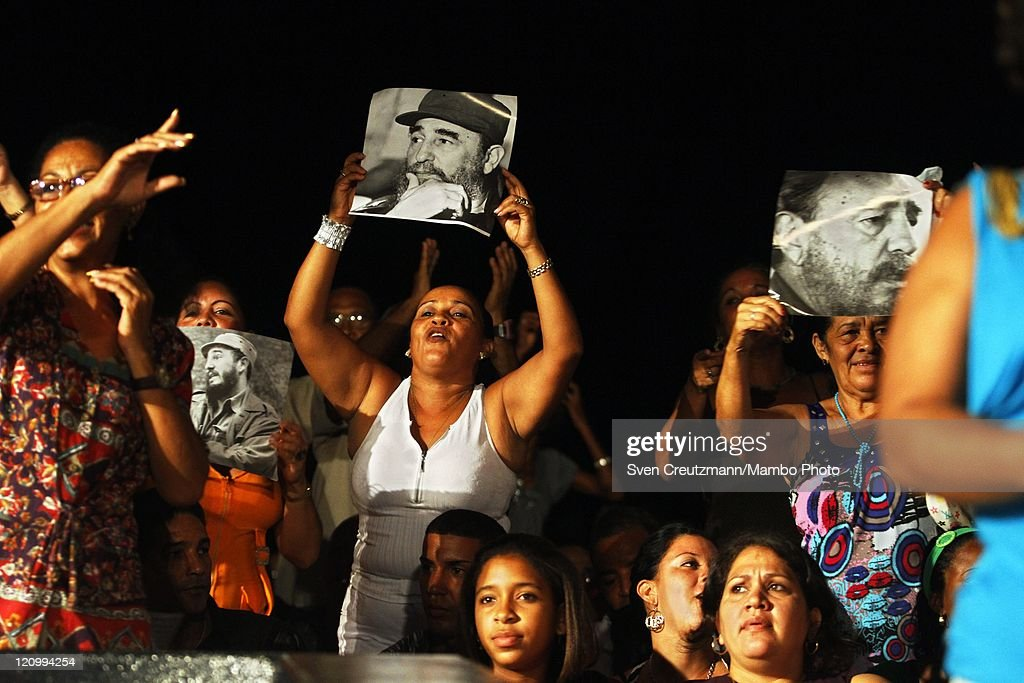 Cuban supporters hold up photos of Cuban Revolution leader Fidel Castro as they dance during a concert of international artists on the eve of the 85th birthday of Cuba's Revolution leader Fidel Castro in the Teatro Karl Marx August 12, 2011 Havana, Cuba. The three hour 'Serenade for Fidelity' (Serenata a la Fidelidad) was organized by the Foundation Guayasemin from Ecuador and the Cuba Ministry of Culture. Fidel Castro fell ill in July 2006 and has stepped back from power, handing over power to his younger brother Raul Castro.