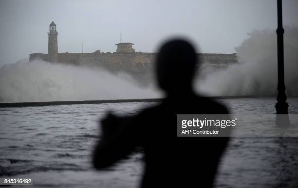 A Cuban takes pictures of huge waves in Havana Malecon on September 10 2017 Deadly Hurricane Irma battered central Cuba on Saturday knocking down...