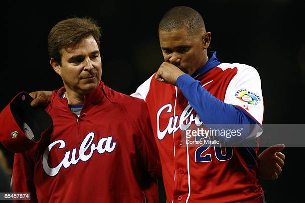 Cuban team doctor Antonio Castro Fidel Castro's son helps Norge Luis Vera of Cuba off the field after injuring his leg while pitching against Mexico...