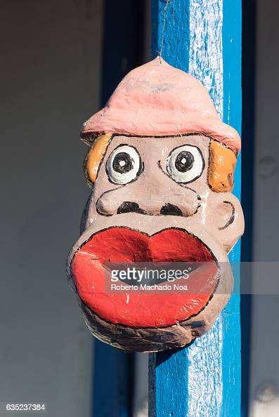 Cuban traditional carnival mask decorating an old colonial house column Carnavales charangas or parrandas large public celebrations dating at least...