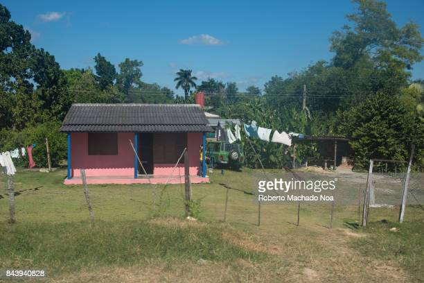 Cuban traditional peasant or farmer house Front yard of small pink county house