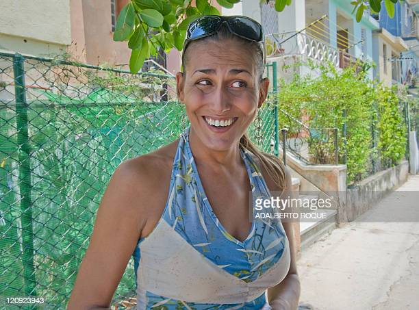Cuban transexual Wendy Iriepa smiles during a interview with AFP on a street of Havana on August 12 2011 Wendy was born a man but he undewent surgery...