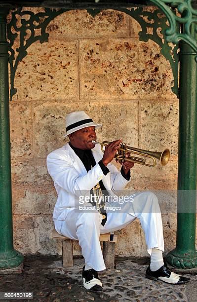 Cuban trumpet player creates music in a small park in Havana Cuba