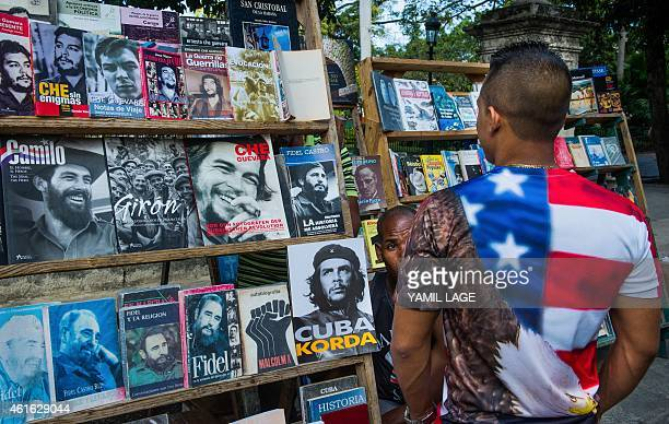 A Cuban wearing a tshirt with the US flag walks along a street of Havana on January 16 2015 The United States will ease travel and trade restrictions...