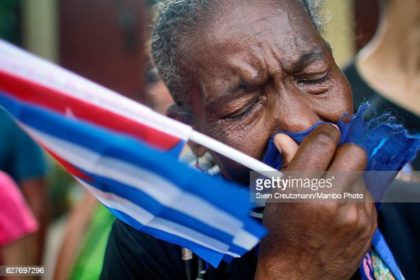 Cuban woman cries after having seen the caravan that carries the remains of Revolution leader Fidel Castro in front of the Moncada barracks on...