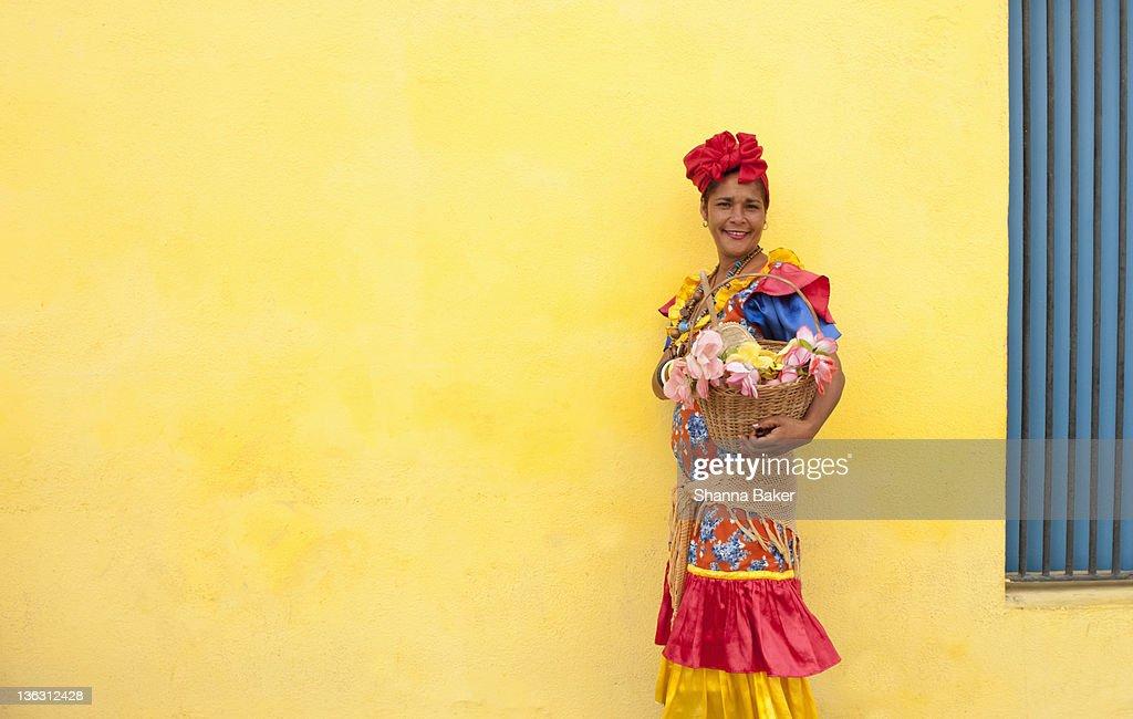 Cuban woman in colourful dress : Stock Photo