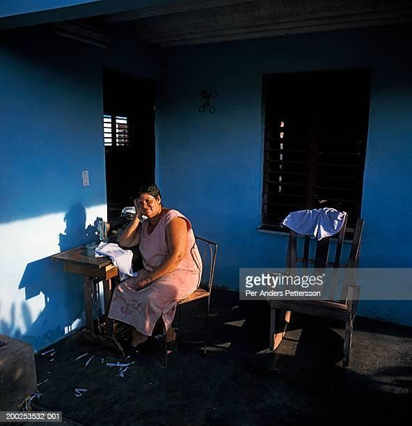 Cuban woman sewing outside her house in Matanza, Cuba