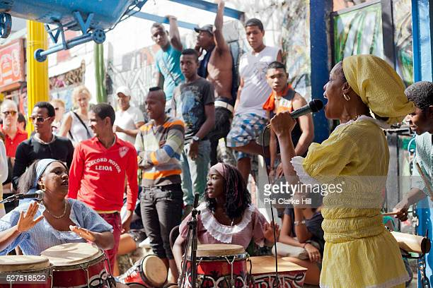 Cuban woman singing and wearing traditional African dress Callejon de Hamel a street art project in old Havana which has a Rumba show on a Sunday...