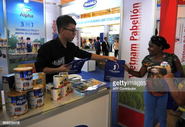 A Cuban woman visits Vietnam's stand during the 35th Havana International Fair on October 30 2017 in Havana / AFP PHOTO / YAMIL LAGE