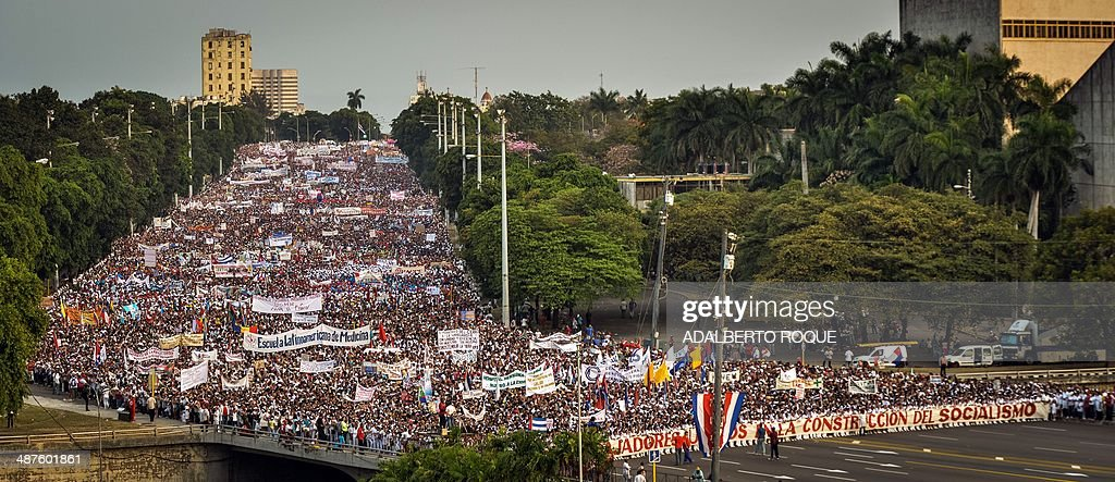 Cuban workers take part in the May Day parade organized by the Cuban Workers Union in Havana on May 1 2014 Some 600000 workers joined the parade...
