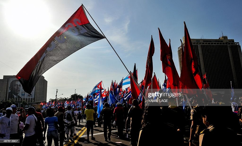 Cuban workers take part in the May Day parade organized by the Cuban Workers Union at Revolution Square in Havana on May 1 2014 Some 600000 workers...