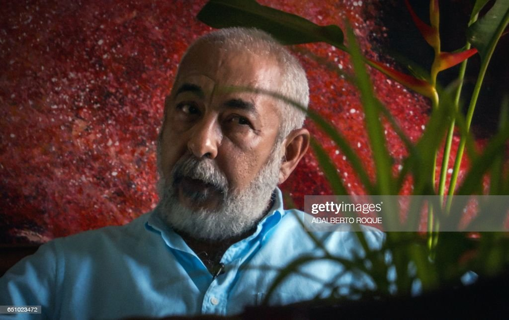 Cuban writer Leonardo Padura gestures during a interview with AFP at his house in Mantilla neighbourhood, Havana on February 7, 2017. /