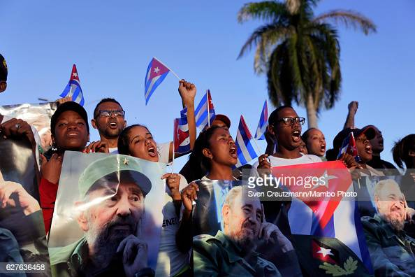 Cuban youth hold images of Fidel Castro as his remains are laid to rest on December 4 in Santiago de Cuba Cuba Cubas former President Fidel Castro...