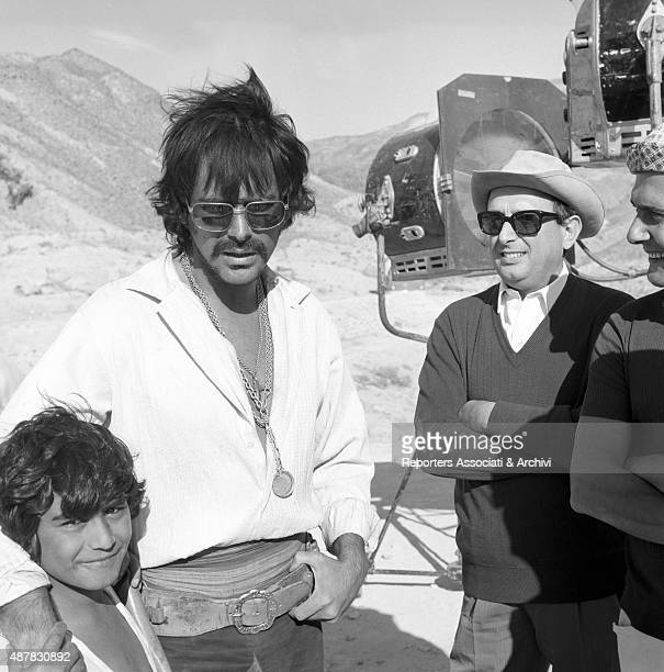 CubanAmerican actor Tomas Milian with a child and two unidentified people in a pause on the set of Tepepa 1968
