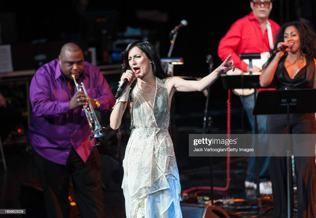 Cuban-American singer Cucu Diamantes performs at Red Hot + Cuba at the BAM Howard Gilman Opera House, Brooklyn, New York, November 30, 2012. With her are Alexander Abreu (left) on trumpet, co-music director Andres Levin (red shirt), and singer Osdalgia Lesmes. The concert was organized in recognition of World AIDS Day (December 1).