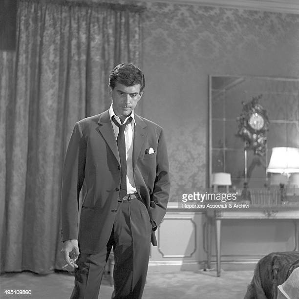 Cubanborn American actor Tomas Milian smoking a cigarette in the episode Il lavoro from the film Boccaccio '70 1961