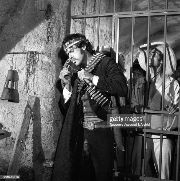 Cubanborn Italian actor and singer Tomas Milian holding a cigar in a prison in a scene from the western movie 'Tepepa' directed by Giulio Petroni...