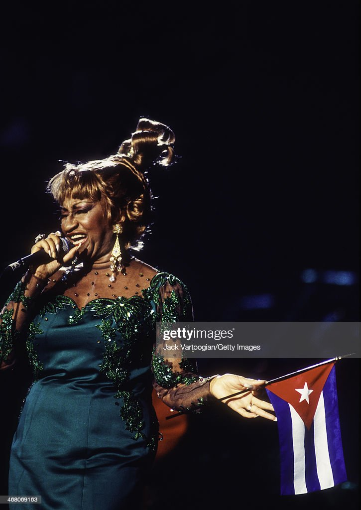 Cuban Born Salsa Singer Celia Cruz 1925 2003 Holds A Cuban Flag As She Performs During The