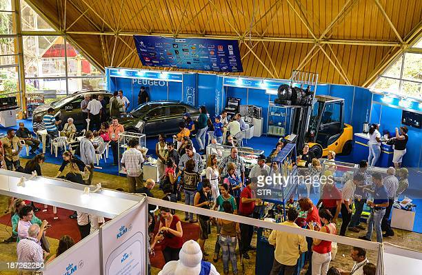 Cubans and foreign businessmen participate in Havana's International Fair at the Expocuba premises on November 7 2013 in havana The Havana...