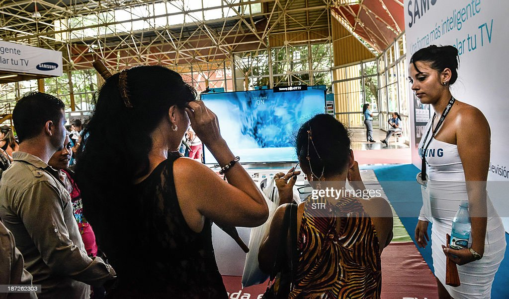 Cubans and foreign businessmen participate in Havana's International Fair (FIHAV), at the Expocuba premises, on November 7, 2013 in havana. The Havana International Fair is the largest annual trade show in Cuba. AFP PHOTO/STR