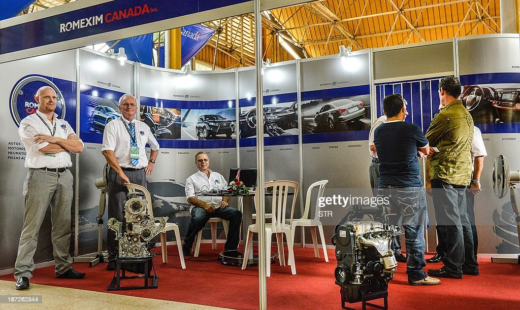 Cubans and foreign businessmen participate in Havana's International Fair (FIHAV), at the Expocuba premises, on November 7, 2013 in havana. The Havana International Fair is the largest annual trade show in Cuba.
