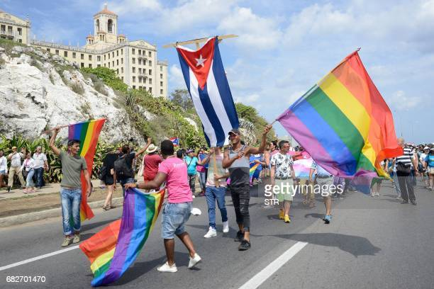 Cubans and foreigners participate in the gay pride parade during the celebration of the day against homophobia and transphobia in Havana on May 13...