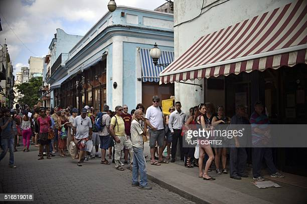 Cubans and tourists queue outside Western Union office to receive money orders in Havana Cuba on March 19 2016 Political and economic reforms in Cuba...