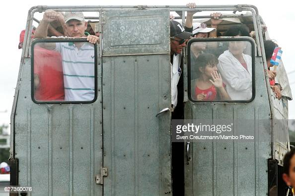 Cubans are transported in a truck after the caravan with the remains of late Revolution leader Fidel Castro passed by on December 1 in Maja Cuba...