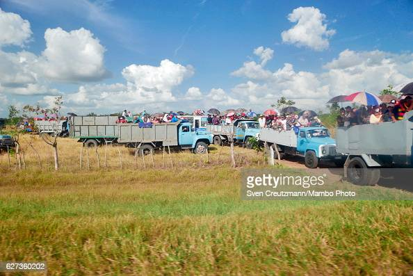 Cubans are transported in trucks after the caravan with the remains of late Revolution leader Fidel Castro passed by on December 1 in Ciego de Avila...