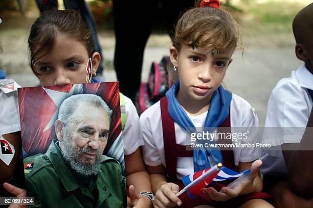 Cubans await the arrival of the remains of Revolution leader Fidel Castro in front of the Moncada barracks on December 3 in Santiago Cuba Cubas...