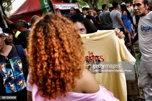 Cubans buy Beatles TShirts for 20 CUP during a concert in tribute to the Beatles on occasion of the 50th anniversary of the Sgt Peppers Lonely Hearts...