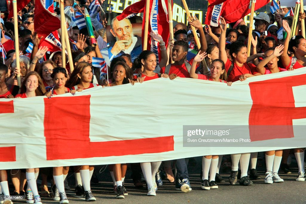 Cubans carry a banner and photo of Revolution leader Fidel Castro on occasion of the upcoming 90th birthday of Castro in August, during a march celebrating workers day, at the Plaza de la Revolucion, on May 1, 2016 in Havana, Cuba. Cuba celebrates workers day shortly before the arrival of the first US American cruise ship to arrive in Cuba, on Monday, May 2, 2016.