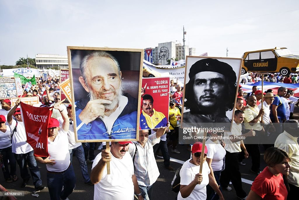 Cubans carry images of Che Guevara Venezuela's President Nicolas Maduro and Cuba's Revolution leader Fidel Castro during the annual march of...