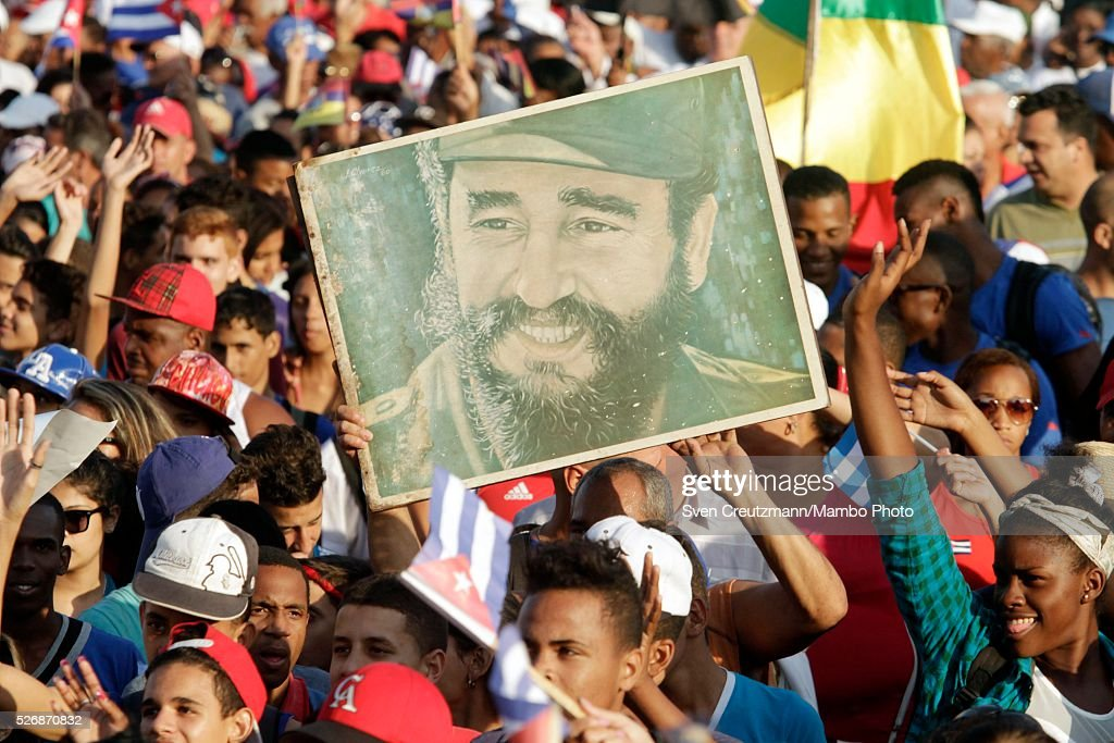 Cubans carry photos of Revolution leader Fidel Castro on occasion of the upcoming 90th birthday of Castro in August, during a march celebrating workers day, at the Plaza de la Revolucion, on May 1, 2016 in Havana, Cuba. Cuba celebrates workers day shortly before the arrival of the first US American cruise ship to arrive in Cuba, on Monday, May 2, 2016.